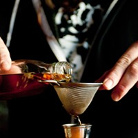 Step-by-step instructions for making Rodan co-owner Eric Chaleff's flu-fighting toddy Using a strainer, pour in an ounce and a half of the tea-infused rum.