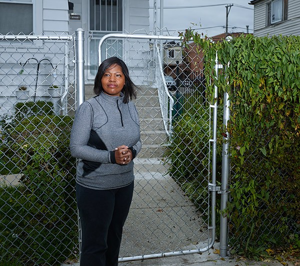 Veronica Coney in front of her Chicago Lawn home