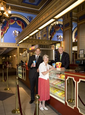 Willis Johnson and family, inside the Tivoli Theater (photo courtesy Classic Cinemas website)