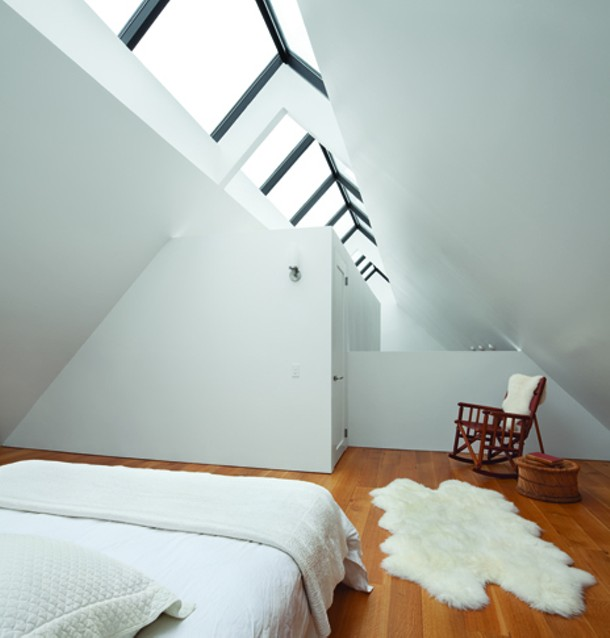 A loft bedroom under the rooftop skylight. - PAUL WARCHOL