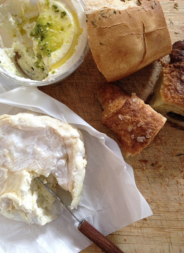 A Modern Milkmaid's Cremenbert and cream cheese with pesto from Betty Acres Farms with what remains of an herb loaf and chocolate croissants with sea salt from Twisted Jeanne's bakery - HILLARY HARVEY