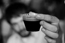 A sample of Chatham Brewing's porter at the New York State Beer Expo at Terrapin Catering on July 17. - EILEEN  CARPENTER