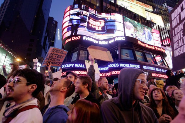 ABC News ticker informs protesters at Times Square in New York City on Saturday, October 15, 2011 that the Occupy movement has gone global.