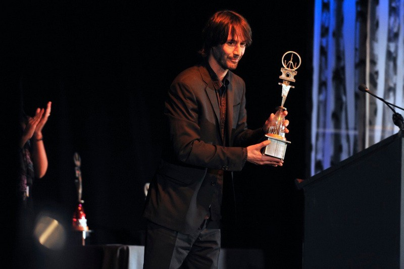 Actor Keanu Reeves accepts an award for Excellence in Acting Award. - BRIAN TOBEY
