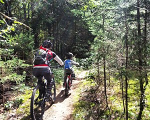 Aidan Kinsley & Lisa Zippo riding the Hardy Road Trail in Willmington, NY, a Fats in the Cats recommendation.