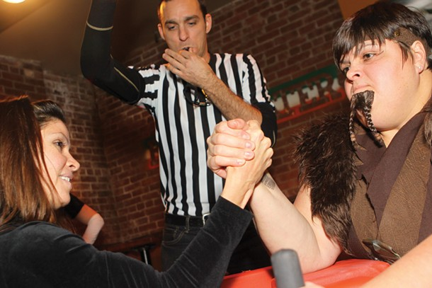 An aspiring amateur takes on BRAWL champ The Beer-barian while referee Michael Wilcock officiates at the BRAWL Ball - on December 3 at the Bridgewater Bar & Grill in Kingston.
