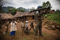 AN INDIAN PEACEKEEPER GUARDING THE MARKET IN KIBUA VILLAGE IN THE WALIKALE REGION OF EASTERN CONGO. - TIM FRECCIA