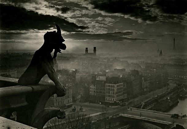 An untitled photograph of a gargoyle atop Notre Dame from Yvon's Paris.