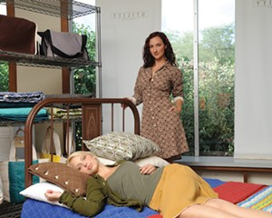 At Utility Canvas, Models Kristina Valts (reclining) and Valerie Cascino (standing). Makeup by Zuleika Hasbrouck for Lovelei Cosmetics. Kristina's outfit: utility canvas long sleeve button down in olive and pleated skirt in honey. Valerie's outfit: Utility Canvas shirred shirtcoat in brown diamonds.