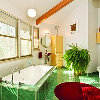 """The Umbrella House Bottom: The master bathroom faces eastward for optimal natural morning light. """"That's the first place you go in the morning, so it's got to be uplifting,"""" Davidson says. Deborah DeGraffenreid"""