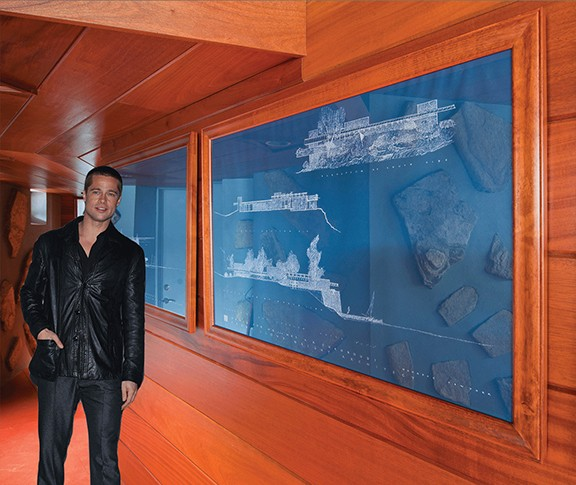 Brad Pitt standing in front of the plans for his new Frank Lloyd Wright inspired home.
