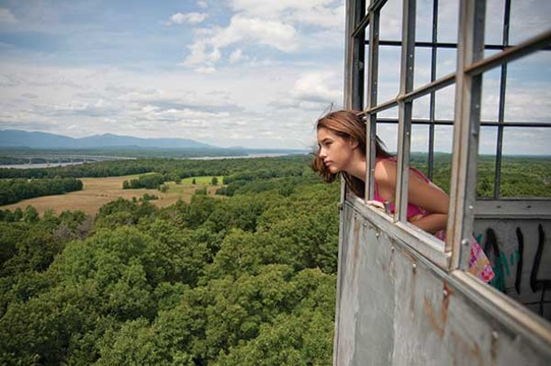 Brianna Cashen looks west from the top of the Ferncliff Forest fire tower in Rhinebeck. - ROY GUMPEL