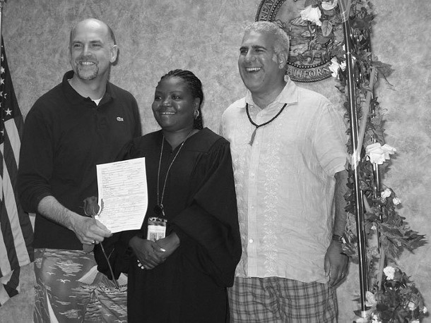 Brook Garrett (holding license) and Jay Blotcher were married by Sharese Bydon, deputy commissioner of Los Angeles County, on July 11, in the - wedding chapel of the county registrar office. - HANK  DONAT