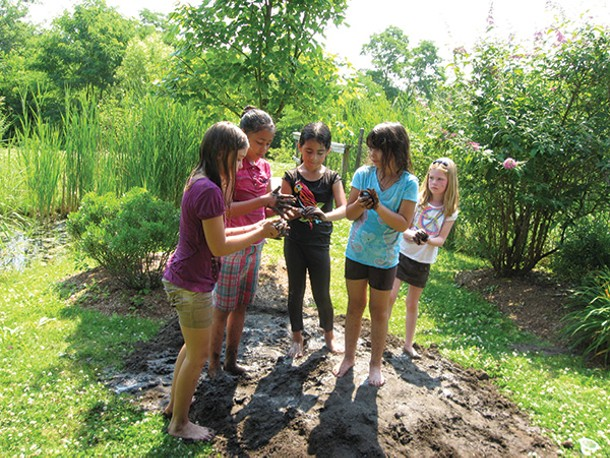 Celebrating Mud Day last May at the natural playscape at the Esopus Library in Port Ewen. - LOIS INGELLIS