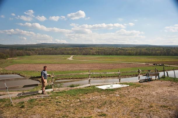 Chris Kelder overlooking the creek that flooded his fields in Accord last fall. - ROY GUMPEL
