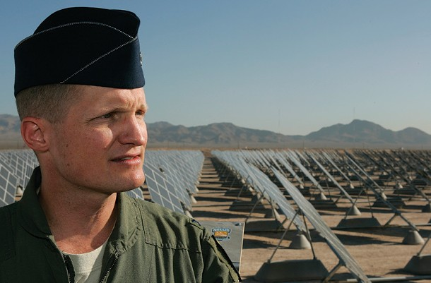 Col. Dave Belote, commander of Nellis Air Force Base, stands on a viewing platform in front of an array of solar photovoltaic panels at the base in Las Vegas, Nevada in this picture taken August 1, 2008. The 15 megawatt plant, consisting of 70,000 panels on 140 acres, provides 30 percent of the base's electricity needs. The U.S. military has a history of fostering change, from racial integration to the development of the Internet. Now, Pentagon officials say their green energy efforts will help America fight global warming. - STEVE MARCUS