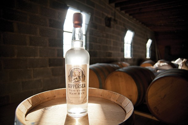 Coppersea's Raw Rye Whiskey among barrels of aging whiskey.. - ROY GUMPEL