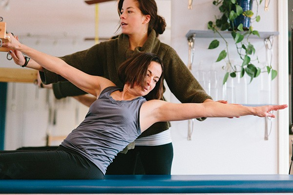 Dawn Shapiro stretches as Kate Fleck intructs at Rhienbeck Pilates. - THOMAS SMITH