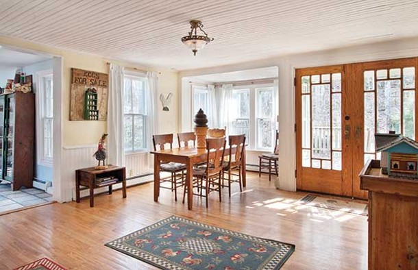 Dining room with doors that open on to the deck overlooking the falls.