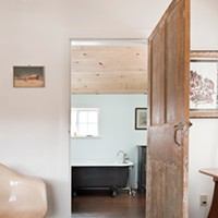 Jeffrey Adkisson's Stockport Salvage Eames chair from Montauk thrift store outside the bathroom