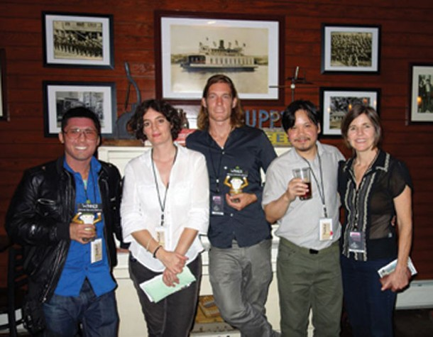 Filmmaker Jonathan Ng, winner of the Audience Award for Requiem for Romance; Lisa Thomas, cofounder of the Athens Animation Festival; Jake Nelson, winner of Best Animation (along with Cem Kurtulus who is not pictured) for The Hungry Boy; Jeremy Jusay, from Augenblick Studios, one of the judges; and Margo Pelletier, cofounder of the Athens Animation Festival, at the first Athens Animation Festival, held at Crossroads Brewery in Athens on September 15. Photo by Alan Skerrett.