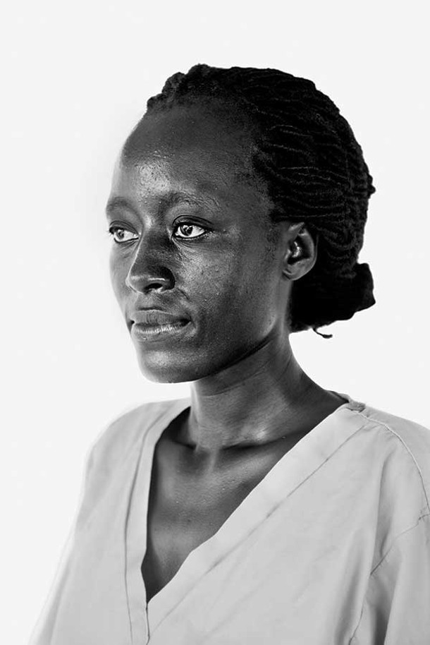 """From the exhibit """"Braving Ebola,"""" a portrait of Kenyan emergency nurse Pares Momanyi, 30, at the Bong County Ebola Treatment Unit in Suakoko, Liberia, on October 12, 2014. - DANIEL BEREHULAK FOR THE NEW YORK TIMES/GETTY IMAGES"""