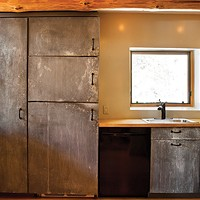 Allan Skriloff's Log Cabin Galvanized cabinets in the kitchen. Deborah Degraffenreid