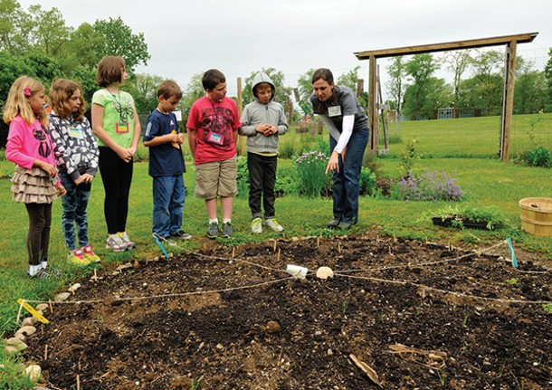 Garden teacher Christine Kurlander with a group of fourth grade students. - DOUG BAZ