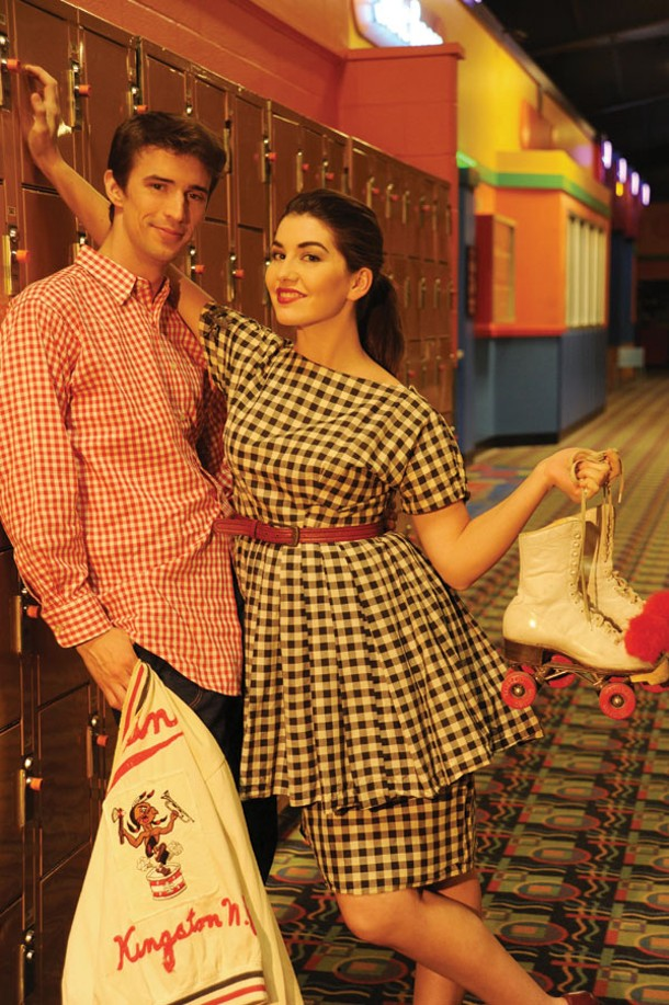 Giddy in Gingham: Samuela Rae wearing handmade gingham dress and red belt. Evan Clayton wearing workwear denim pants, red gingham buttercup shirt, and Kingston drum and bugle corps jacket. Makeup by Samuela Rae. From outdated café. - KELLY MERCHANT