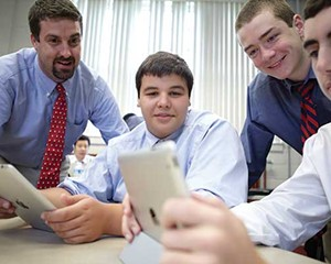 Gonzalo Garcia-Pedroso and students watch news clips as part of a discussion of current events at South Kent School.