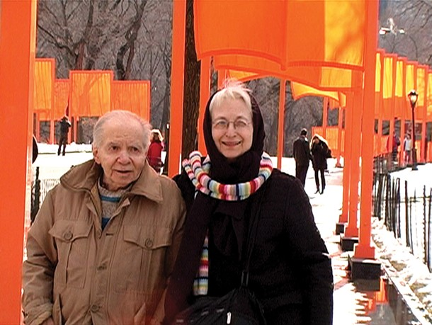 """Herb and Dorothy Vogel walking through Christo's """"The Gates"""" in Central Park in 2005."""