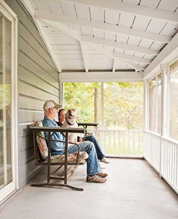 Himberger, Walsh, and Chester the yellow lab on the porch.