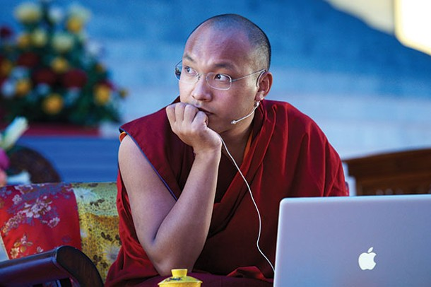 His Holiness the 17th Karmapa works on his laptop at the Kagyu Monlam Pavilion in Bodgaya, India. - FILIP WOLAK