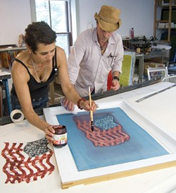 """Inking a screen in Laureen Griffen's """"Fabric Printing with Dye"""" workshop at Women's Studio Workshop in Rosendale earlier this Summer."""