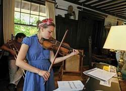 Iona Gitt-Henderson rehearsing for the Fall Arts orchestra performance at buxton school.
