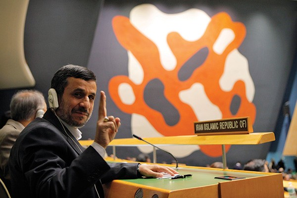 Iran's President Mahmoud Ahmadinejad flashes the peace sign during the high-level meeting of the General Assembly on the Rule of Law in New York on September 24, 2012. - EDUARDO MUNOZ / REUTERS