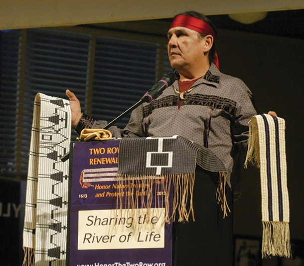 Jake Edwards of the Onondaga Nation Council of Chiefs holding the Canandaigua Treaty Belt and the Two Row Wampum Belt at event in January in Syracuse.