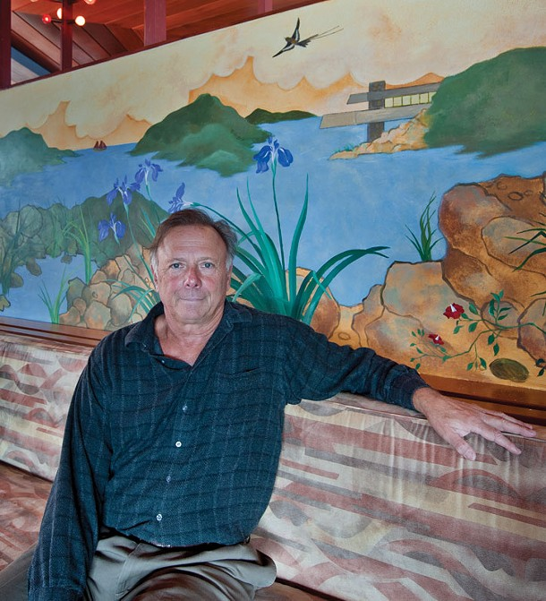 Joe Massaro in front of a mural he commissioned for the house, based on a mural in Wright's Socrates Zaferiou House in Blauvelt, NY. (Note the Massaro House in the mural.)