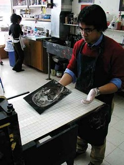 Joe Wichitchu in the printmaking studio at Hotchkiss School in Lakefield, CT.