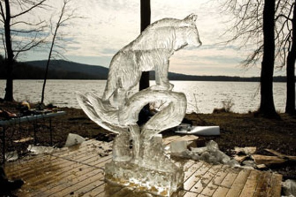 """John Hedbavny of New Paltz won the """"Fan Favorite"""" award at the sixth annual Knickbocker Ice Festival at Rockland State Park in Clarkstown on January 29 with his sculpture of a wolf. - MYLES ARONOWITZ"""