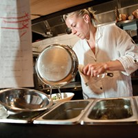 Fish & Game Jori Jayne Emde cooking in the restaurant's kitchen. Roy Gumpel