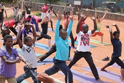 wl_karma-yoga_thecrowd-taking-the-class-rwanda.jpg