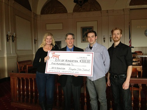 Kingston Film Festival organizers Astrid Cybele, Trevor Dunworth, Dan Votke of BSP present Kingston Mayor Shayne Gallo with $500.