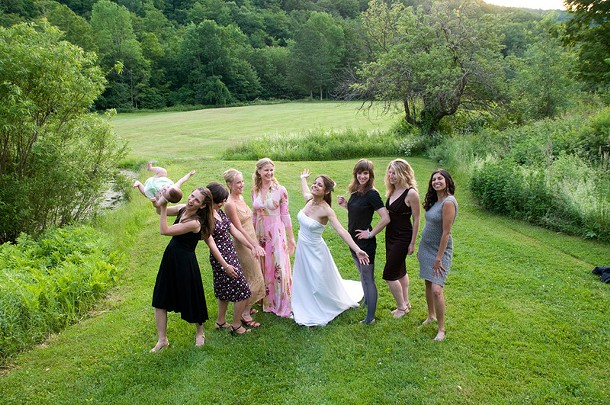 Laura Viggiano pauses for a picture with friends during her wedding at Full Moon Resort in Shandaken. - HILLARY HARVEY