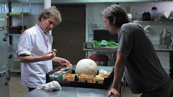 Lucien (Jason Cortlund, right) selling foraged mushrooms to Duncan (Eric Dean Scott) in a scene from Now, Forager.