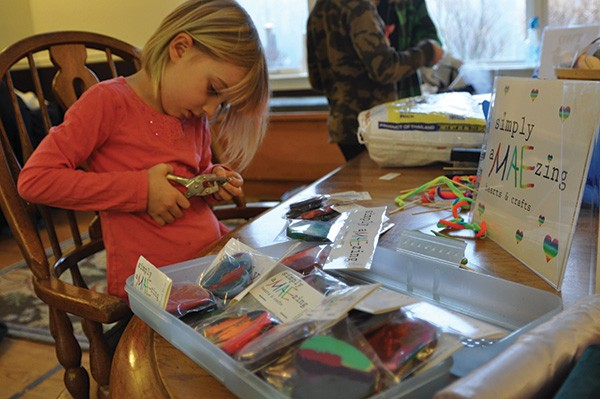 Mae Gallagher prepares crafts for the Hudson Valley Sudbury School's craft sale. - IMAGE PROVIDED