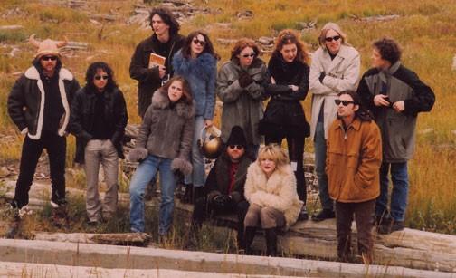 Members of Hole, Veruca Salt, and Metallica gather at the The Molson Ice Beach Polar Beach Party in the Inuvialuit hamlet of Tuktoyaktuk, Canada in 1995. L to R: James Hetfield (Metallica), Kirk Hammett (Metallica), Jim Shapiro (Veruca Salt, with book), Louise Post (Veruca Salt, grey coat in first row), Nina Gordon (Veruca Salt, blue coat in rear row), Patty Schemel (Hole, back row), Lars Ulrich (Metallica, seated), Courtney Love (Hole, seated), Melissa Auf der Maur (Hole, back row), Eric Erlandson (Hole, back row), Steve Lack (Veruca Salt, front row), Jason Newstead (Metallica, back row).