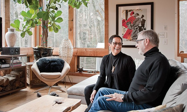 Michele and Ed in the living room. Of note: On extreme left, a media cabinet Michele designed and custom made by Tony Gorga of New York Handmade in Red Hook, to consolidate media equipment, firewood, and fireplace tools. - DEBORAH DEGRAFFENREID