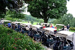 PAMELA FREEMAN - Millbrook Golf & Tennis Club. Golf carts lined up and ready to go.