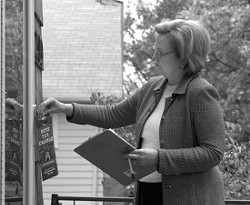 "Missouri Senate candidate Democrat Claire McCaskill places a ""door hanger"" while canvassing a Kansas City neighborhood during the last day of her campaign against incumbent Senator Jim Talent on November 6. McCaskill's victory over talent assured a Democratic majority in the Senate. REUTERS/Dave Kaup"